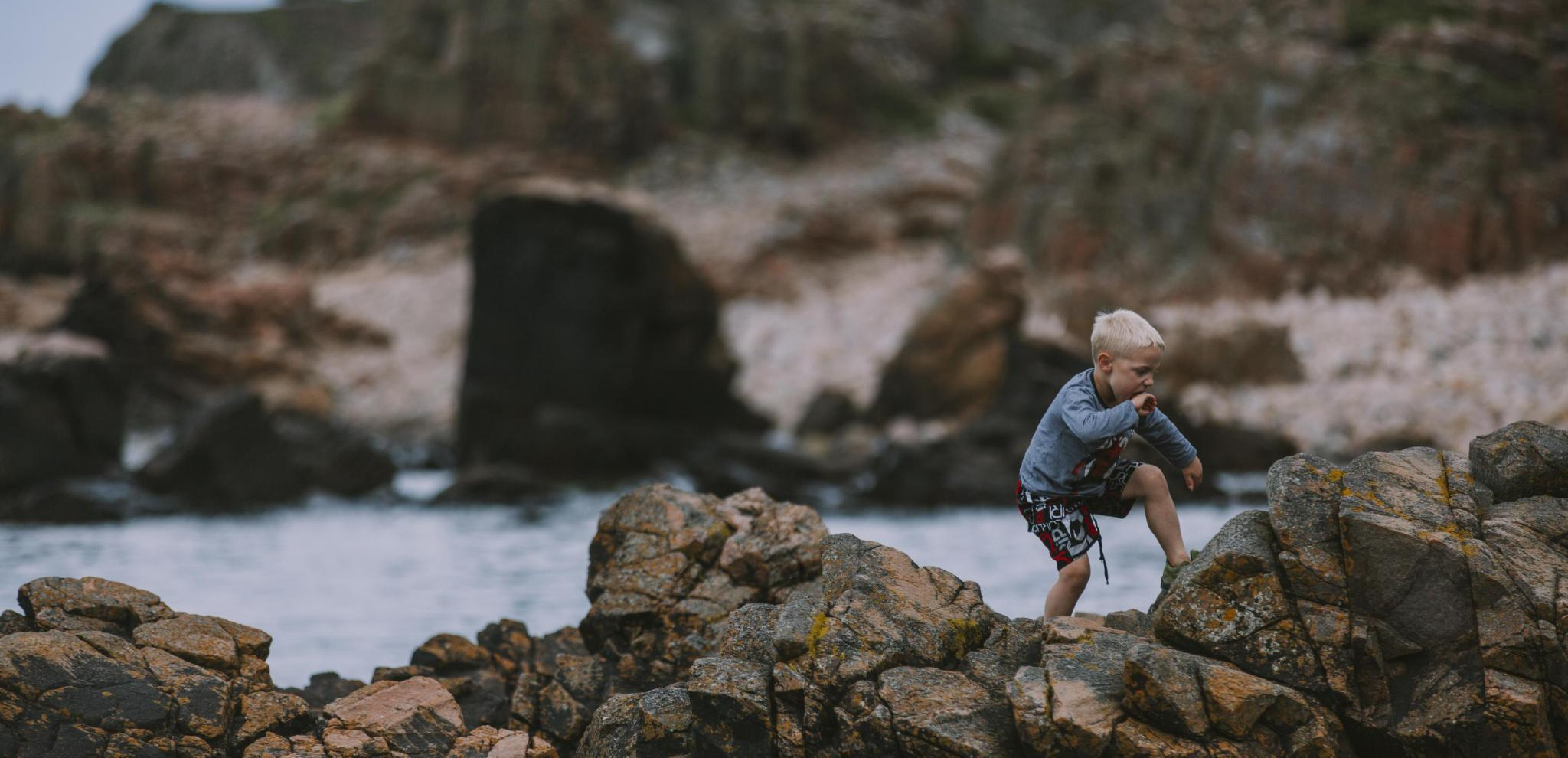 Kid jumping on Hovs Hallar rocks