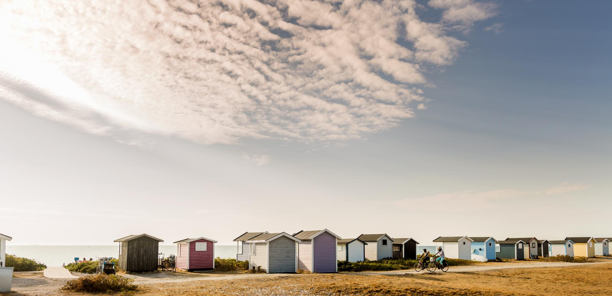 Bathing huts by the coastline on a sunny day