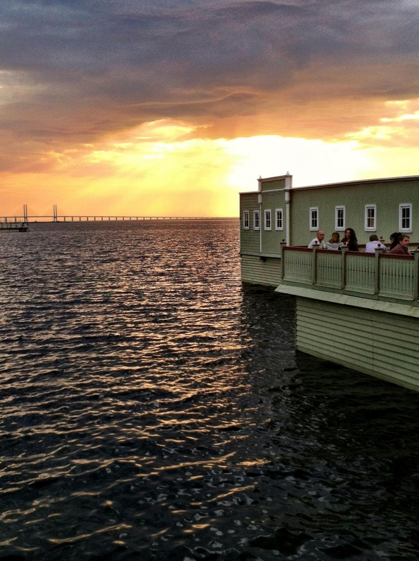 View of the sundown behind The Öresund Bridge and Ribersborg's cold bath house