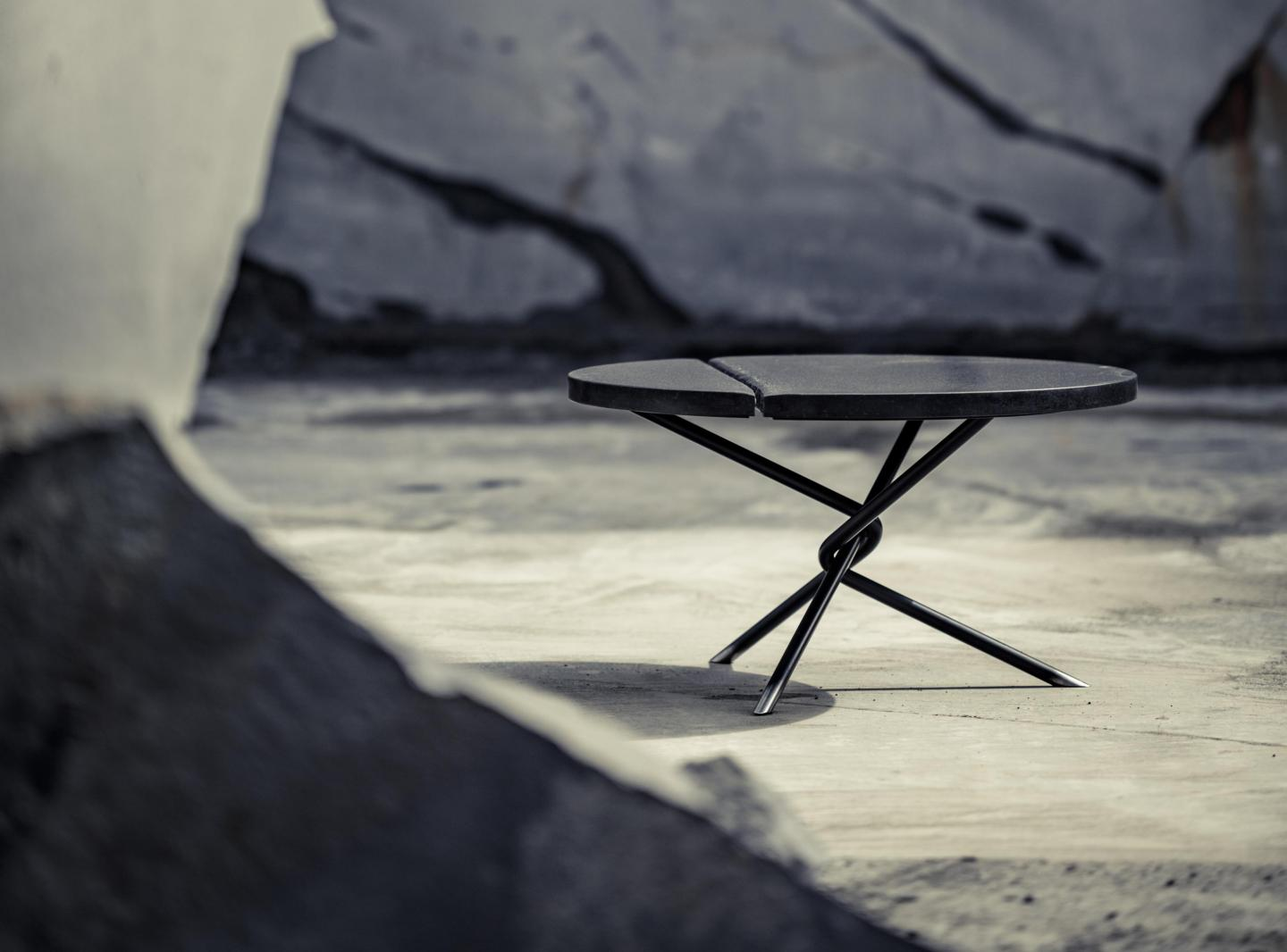 Balck coffee table surrounded by cliffs