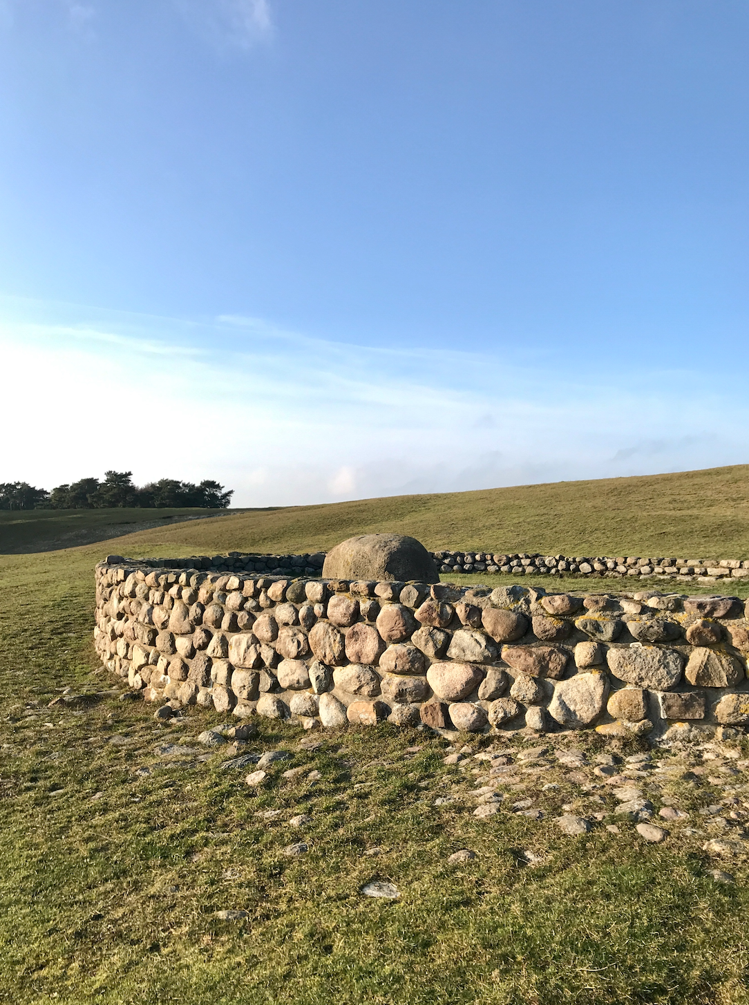 Round stone wall in a field
