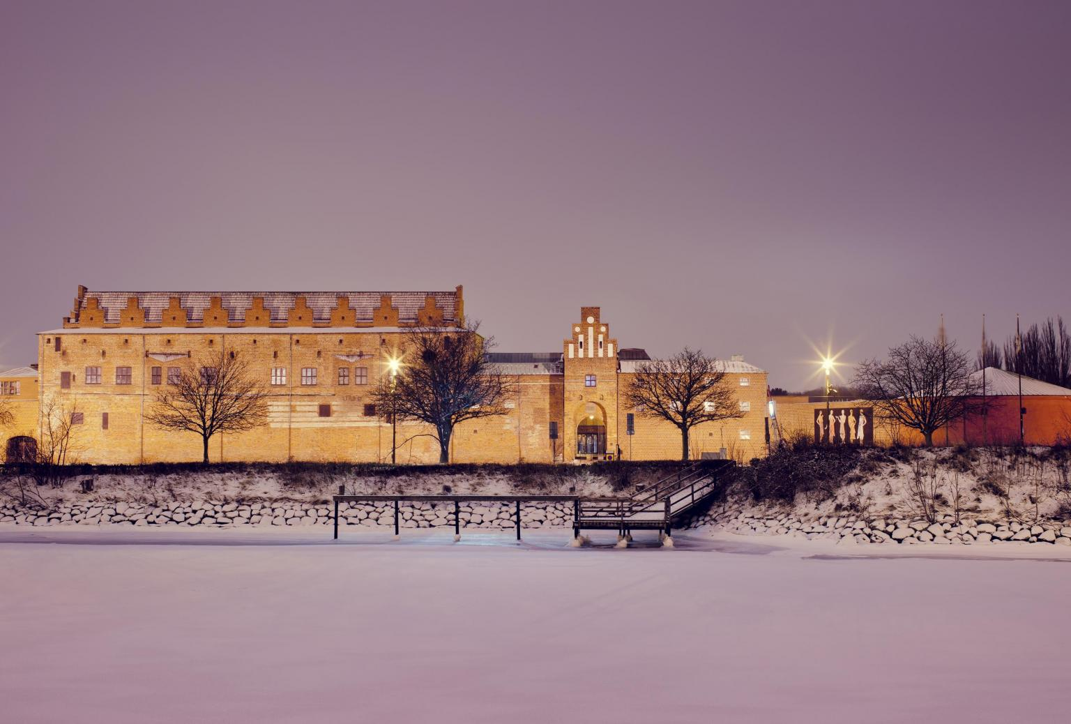 Malmöhus castle in the wintertime covered with snow at night