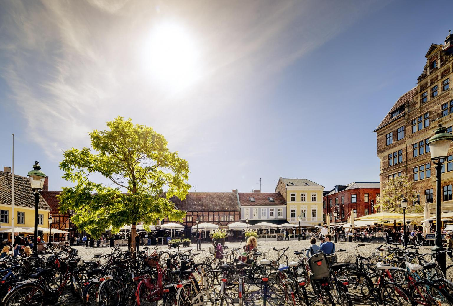 Bicycles parked at Lilla torg in Malmö on a sunny summer day