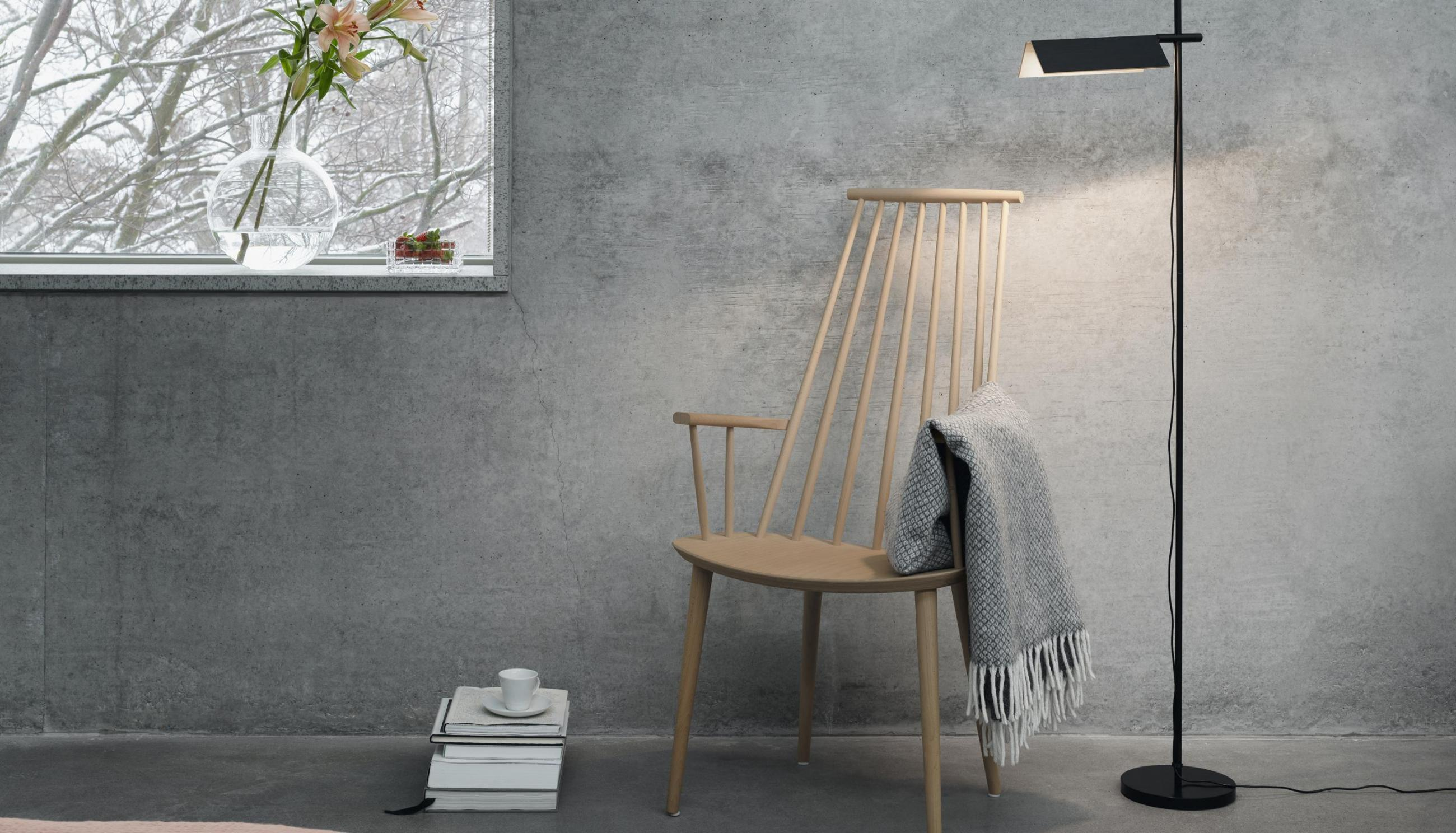 Grey room with rocking chair, blanket and a floor lamp