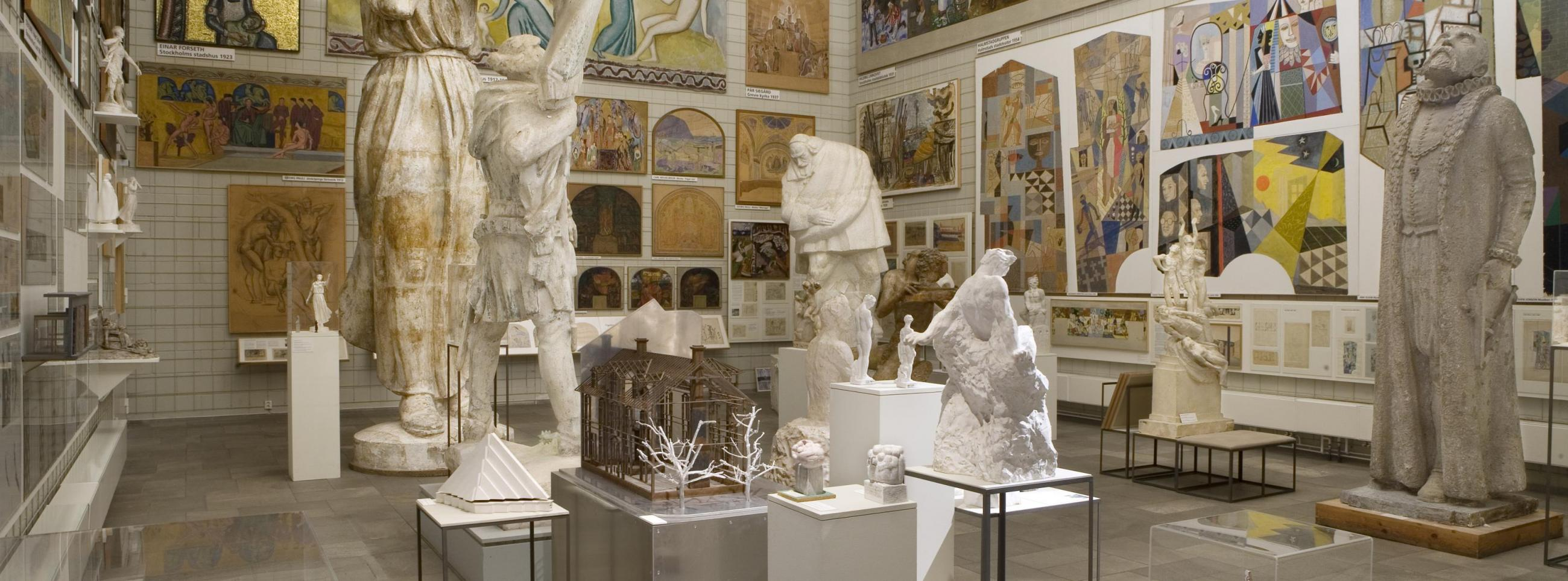 A room covered with painting and large antique sculptures at Skissernas museum