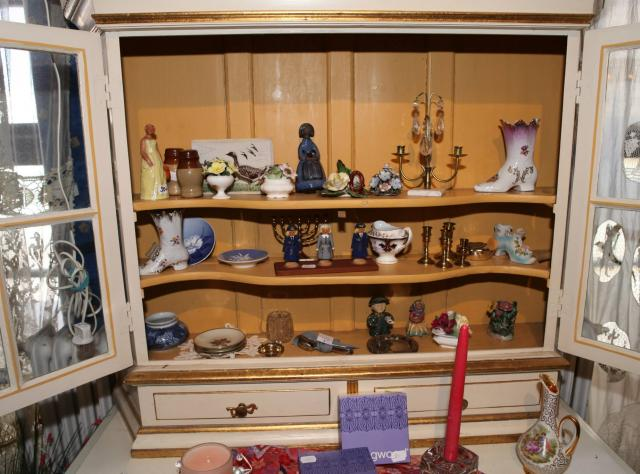 Porcelain figurines in a cabinet © John W. Ford Photography