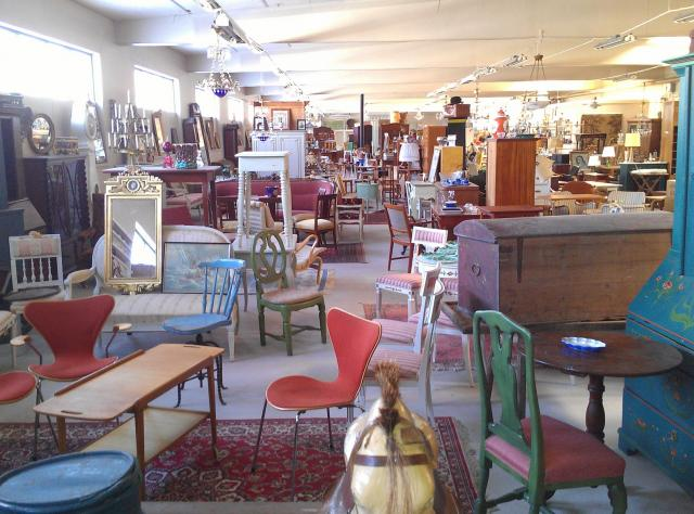Various vintage chairs and cabinets